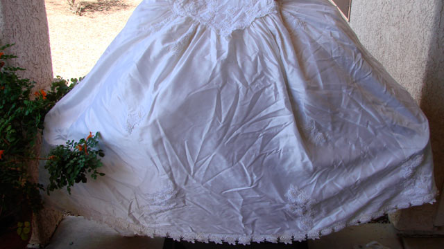 PHOTO: Want to protect your grill? Borrow your ex's wedding gown!