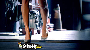 PHOTO: Screen shot of the 2011 Go Daddy Super Bowl Commercial. Go Daddy?s seventh Super Bowl advertising campaign goes live. A large number of the company?s 2,950 employees will be glued to computer monitors tracking visits.