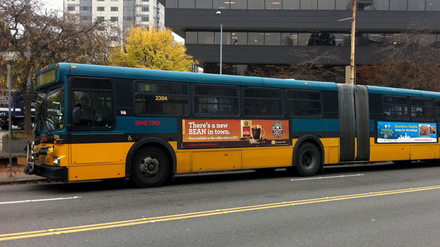 "PHOTO: A local groups plan to buy ads on Seattle Metro buses urging people to ""Buy American"" and ""Shop Locally"" has been rejected by King County as too political."