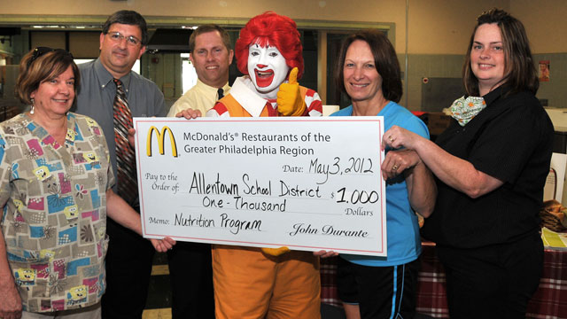 PHOTO: From left: Donna Schuler, Joe Bonita, David Hahn, Ronald McDonald, Vickie Kahler, and Sue Ennis, present a $1,000 donation from McDonalds to support nutrition and fitness education for ASD elementary students.