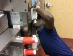 PHOTO: A photo of a Wendy?s employee eating from a Frosty machine was shared on website Reddit.