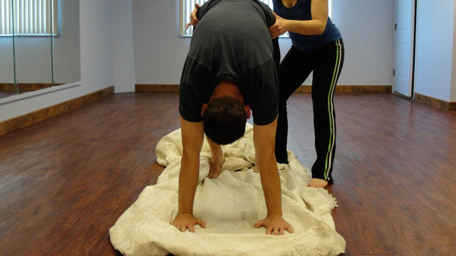 PHOTO: Kevin Cotter thought his ex wife's wedding dress would be a great place to practice his Sun Salutations.