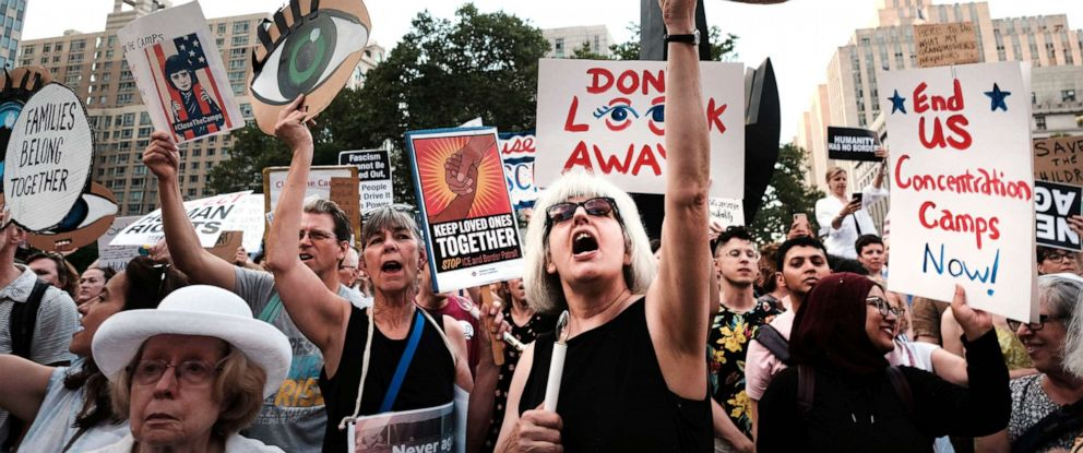 """PHOTO: Hundreds of people gather in lower Manhattan for a """"Lights for Liberty"""" protest against migrant detention camps and the impending raids by Immigration and Customs Enforcement this coming weekend in various cities on July 12, 2019 in New York City."""