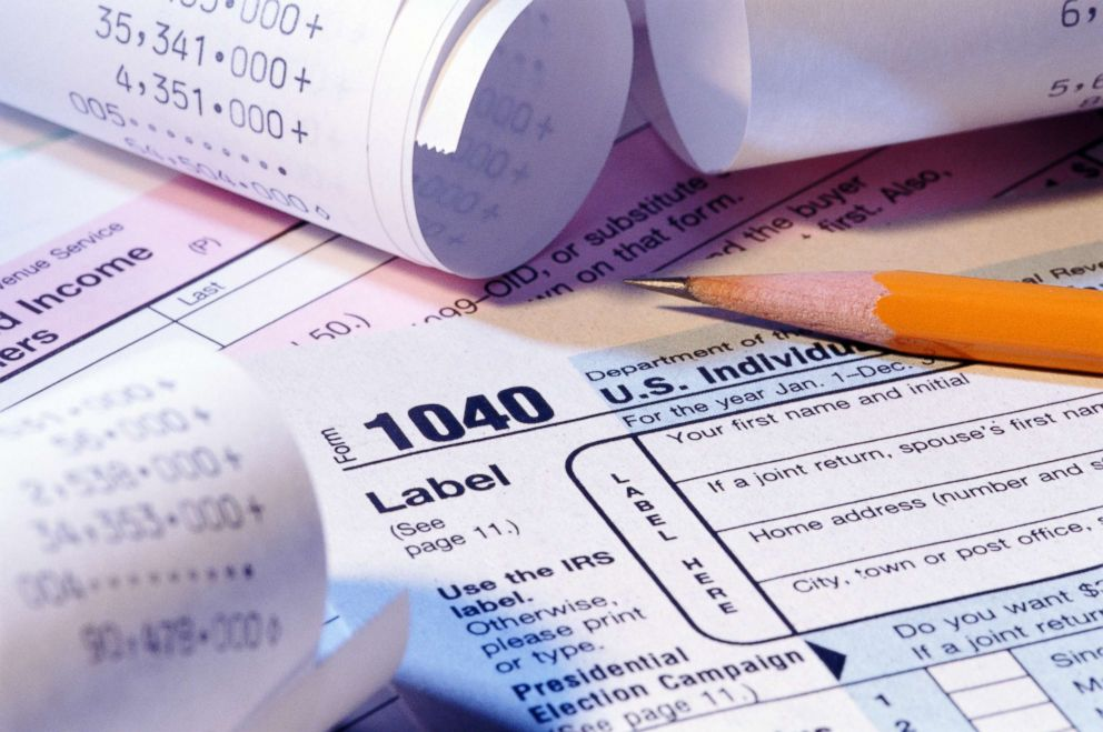 PHOTO: A tax form, receipts and pencil are pictured in this undated stock photo.