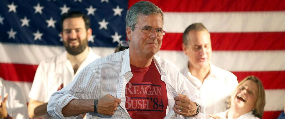 PHOTO: Former Florida Governor Jeb Bush shows off a Reagan/Bush 84 tee-shirt as he speaks during a Miami field office opening, Sept. 12, 2015, in Miami.