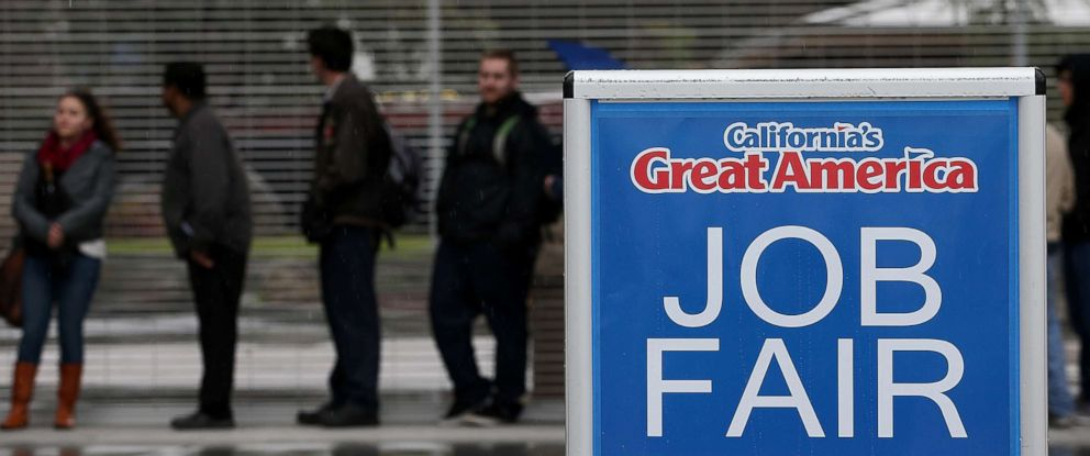 PHOTO: Job seekers wait in line to register for a job fair at Californias Great America theme park on Feb. 6, 2015 in Santa Clara, Calif.