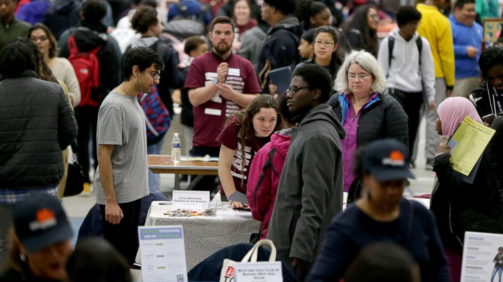 People attend a youth job and resource fair at the Reggie Lewis Track and Athletic Center in the Roxbury neighborhood of Boston, March 10, 2018.