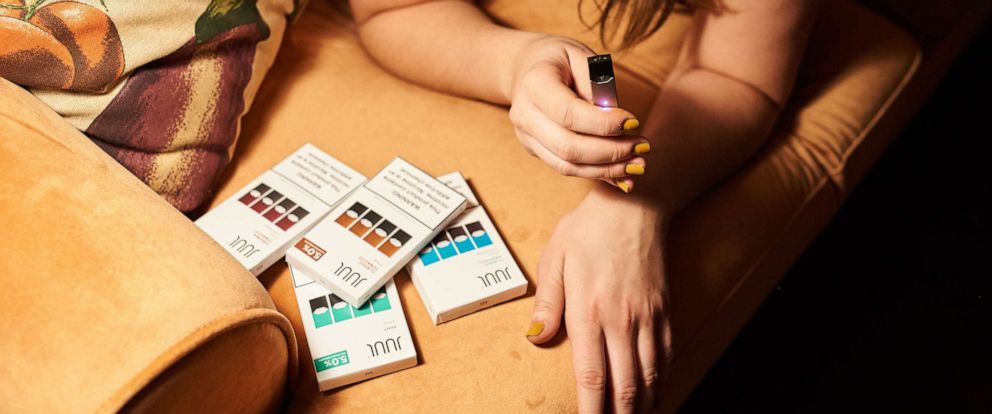 PHOTO: A person smokes a Juul Labs Inc. e-cigarette in this arranged photograph taken in the Brooklyn Borough of New York, U.S., on Thursday, Dec. 20, 2018.