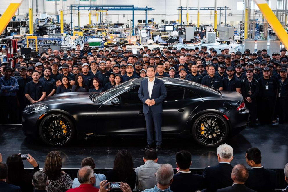 PHOTO: Dr. Lance Zhou, CEO of Karma Automotive, presenting the first Revero car at the companys Customization & Innovation Center in Moreno Valley, California.