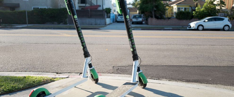 "PHOTO: Two scooters from dockless electric scooter sharing economy company Lime are parked in a ""hub"" near a road in Marina Del Rey, Los Angeles, Oct. 21, 2018."
