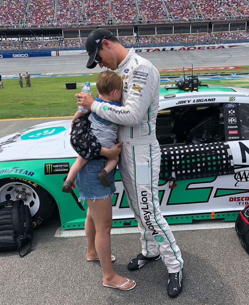 PHOTO: Joey Logano and his family share a sweet moment before a NASCAR race at Talladega Superspeedway, April 28, 2019.