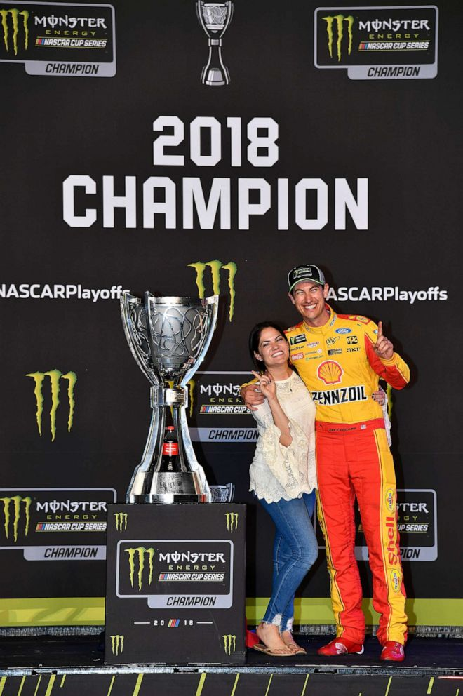 PHOTO: Joey Logano and his wife Brittany posing next to the Monster Energy NASCAR Cup Series championship trophy.