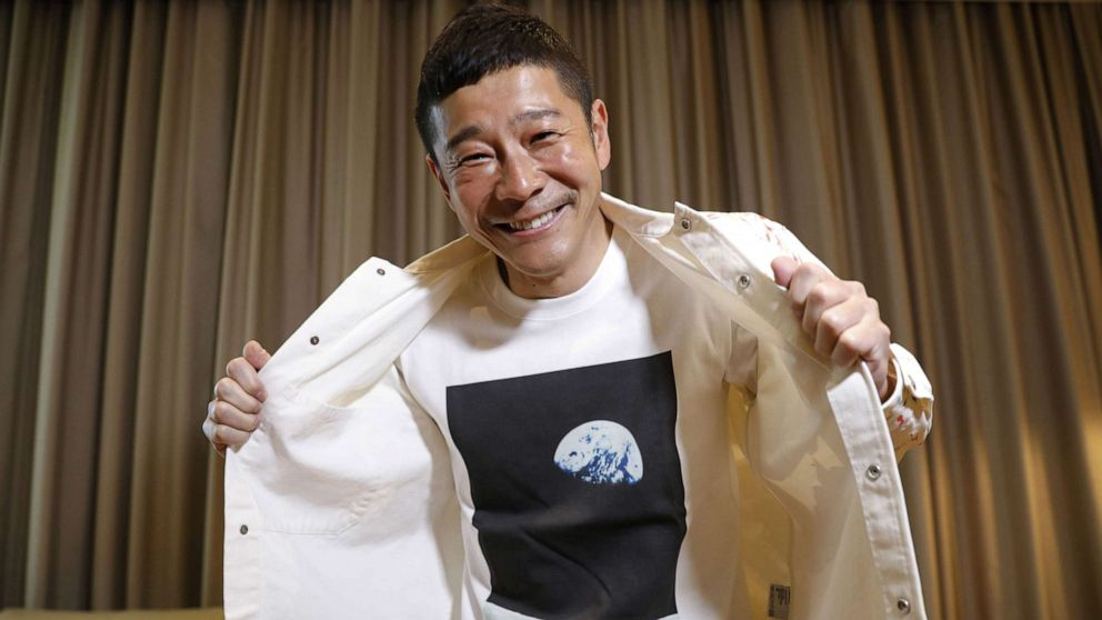 PHOTO: Japanese billionaire Yusaku Maezawa poses with his T-shirt bearing an image of Earth during an interview with Reuters in Tokyo, March 3, 2021.