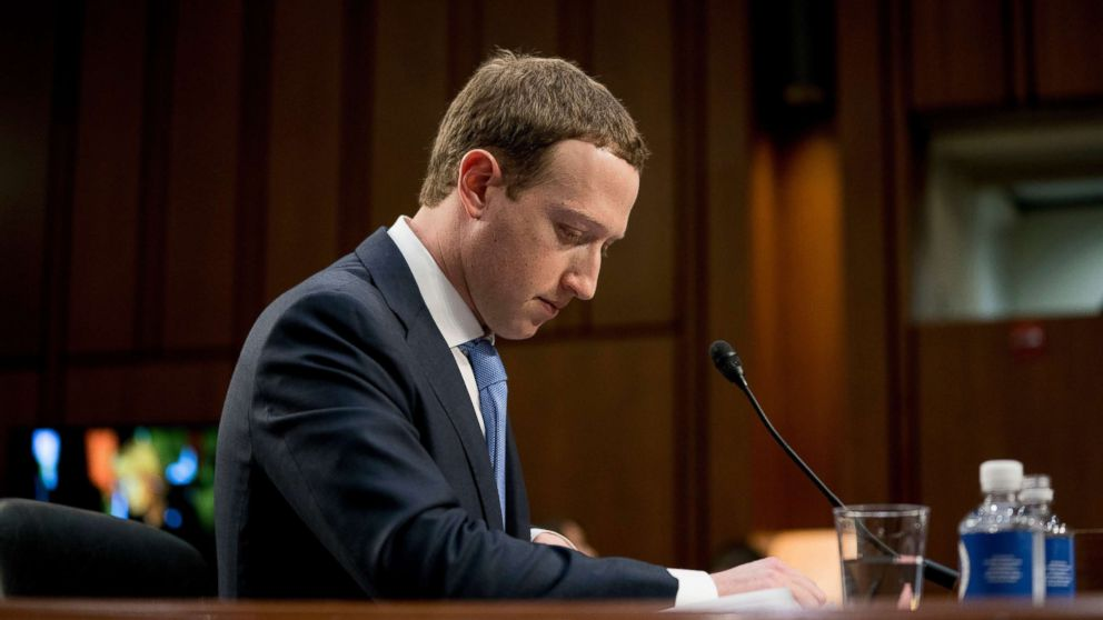 Facebook CEO Mark Zuckerberg pauses while testifying before a joint hearing of the Commerce and Judiciary Committees on Capitol Hill in Washington, April 10, 2018.