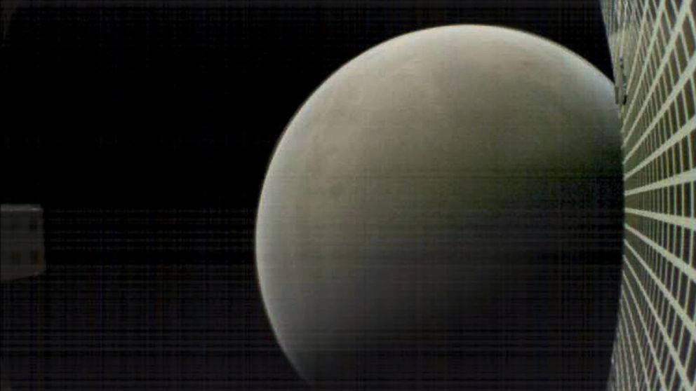 This NASA image obtained November 27, 2018 shows what MarCO-B, one of the experimental Mars Cube One CubeSats, captured in this image of Mars from about 4,700 miles away during its flyby of the Red Planet on Nov. 26, 2018.