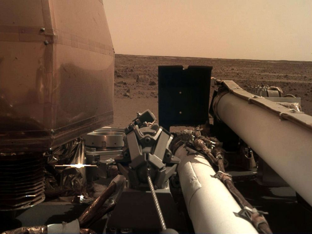 PHOTO: The NASA InSight took this photo of the surface of Mars using its robotic arm-mounted, Instrument Deployment Camera after touching down on the surface of the planet, Nov. 26, 2018.