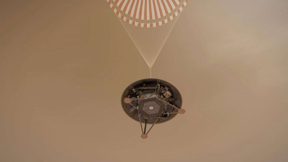 An undated handout illustration made available by NASA shows a simulated view of NASA's InSight lander descending towards the surface of Mars on its parachute.