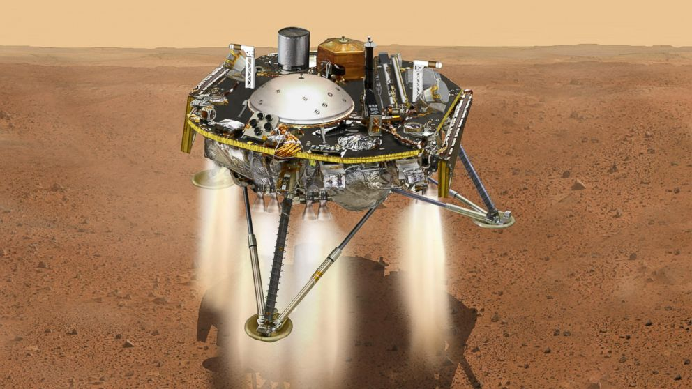 This NASA illustration shows a simulated view of NASA's InSight lander firing retrorockets to slow down as it descends toward the surface of Mars.