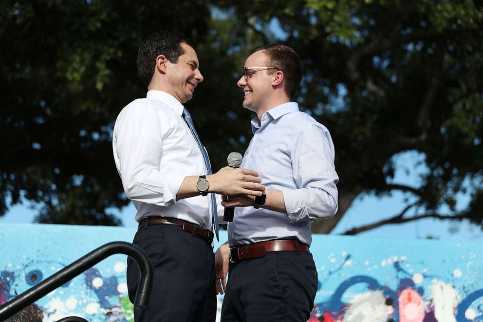 PHOTO: Democratic presidential candidate Pete Buttigieg is introduced by his husband, Chasten Glezman Buttigieg, during a grassroots fundraiser on May 20, 2019, in Miami.