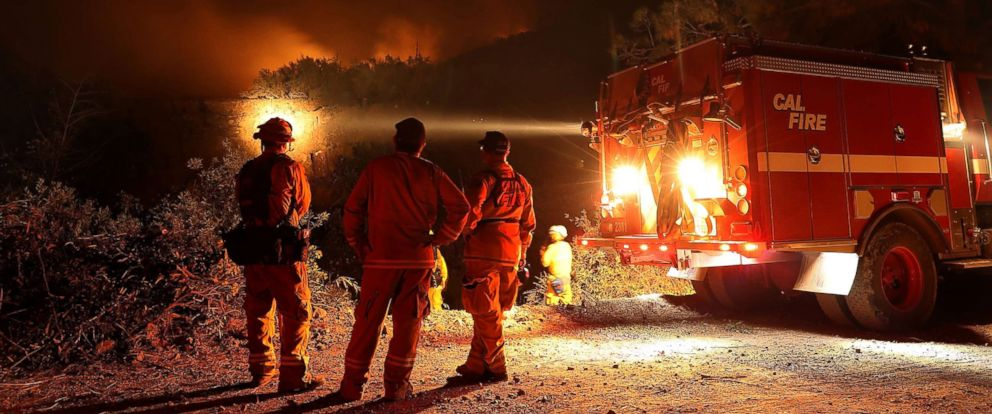 PHOTO: Cal Fire firefighters monitor a back fire while battling the Medocino Complex fire, Aug. 7, 2018, near Lodoga, California.
