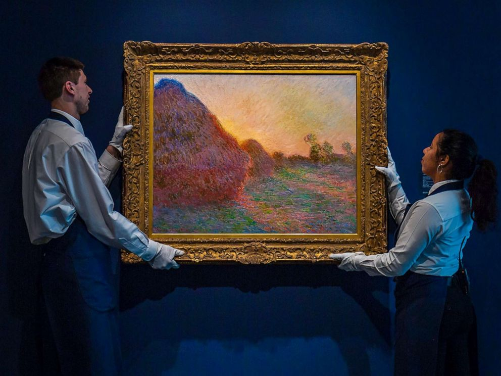 PHOTO: Claude Monets painting titled Meules is hung before being auctioned. The painting, one of Monets iconic paintings, fetched a record $110.7 million at an auction in New York, May 14, 2019.