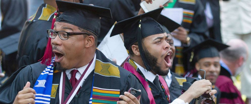 PHOTO: Graduates react after hearing billionaire technology investor and philanthropist Robert F. Smith say he will provide grants to wipe out the student debt of the entire 2019 graduating class at Morehouse College in Atlanta, May 19, 2019.