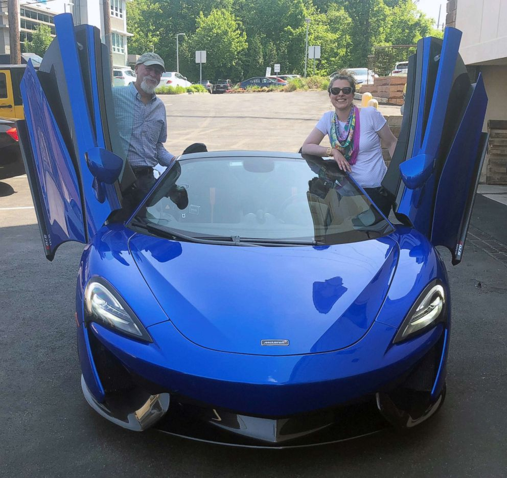 PHOTO: Morgan Korn and her dad Buz Korn posing with a McLaren 570S Spider, May 23, 2018.
