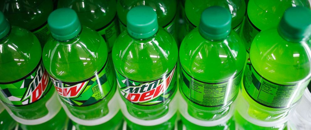 PHOTO: Bottles of PepsiCo Inc. Mountain Dew brand soda are displayed for sale inside a convenience store in Bagdad, Kentucky, Feb. 11, 2018.