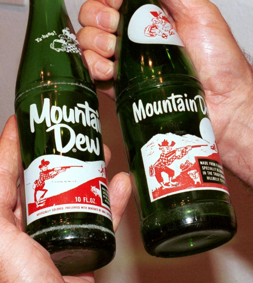 PHOTO: A Mountain Dew bottle from the middle 1960s, left, and a bottle from the late 1950s are compared, Aug. 6, 2001, at the Reece Museum at East Tennessee State University in Johnson City, Tenn.
