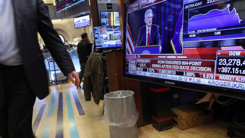 Traders work on the floor of the New York Stock Exchange as the Federal Reserve Board Chairman Jerome Powell holds a news conference on Dec. 19, 2018 in New York.
