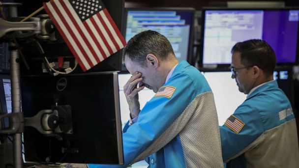 Dow closes down over 600 as Trump, China argue over tariffs