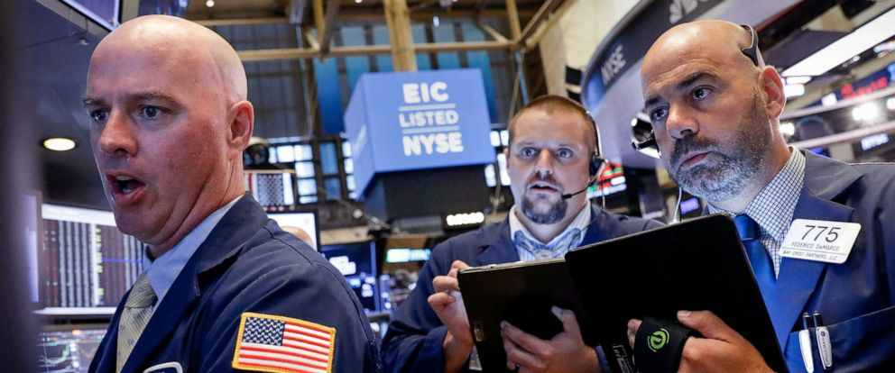 PHOTO: Traders work on the floor at the New York Stock Exchange (NYSE) in New York, Aug. 7, 2019.