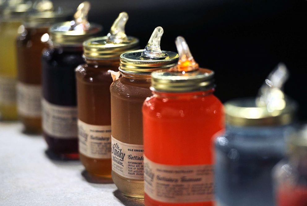 PHOTO: Jars of moonshine for sampling at Ole Smoky Distillery in Gatlinburg, Tenn.