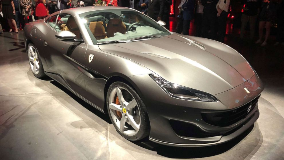 The latest Ferrari model is the Portofino, which has a retractable hardtop roof.