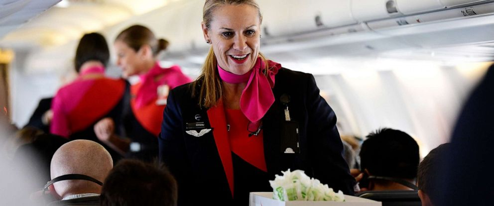 PHOTO: A crew member serves a meal wrapped in Qantas new biodegradable and recyclable food and beverage packaging on Qantas flight QF739 from Sydney to Adelaide, Australia, May 8, 2019, for the worlds first zero waste to landfill flight.