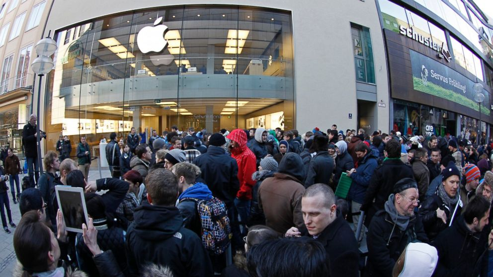 People crowd in front of an Apple store in Munich, Germany, in this March 16, 2012 photo.