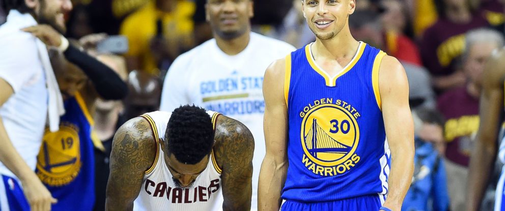 PHOTO: Golden State Warriors guard Stephen Curry reacts next to Cleveland Cavaliers guard J.R. Smith in the closing seconds of game six of the NBA Finals at Quicken Loans Arena, June 16 2015 in Cleveland.