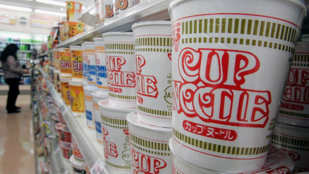 """Japanese instant-noodle maker Nissin Food Products' """"Cup Noodle"""" are stacked at a convenience store in Tokyo on Nov. 15, 2006."""