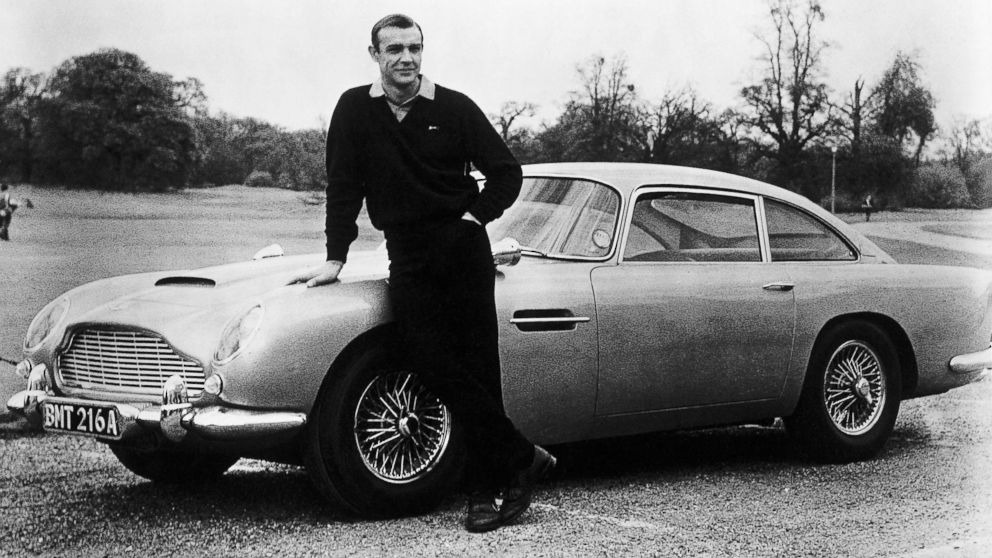 In this file photo, actor Sean Connery, the original James Bond, is pictured here on the set of Goldfinger with one of the fictional spy's cars, a 1964 Aston Martin DB5.