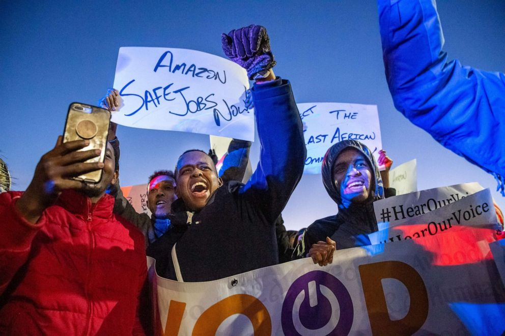 PHOTO: Demonstrators shout slogans and hold placards during a protest at the Amazon fulfillment center in Shakopee, Minn., Dec. 14, 2018.