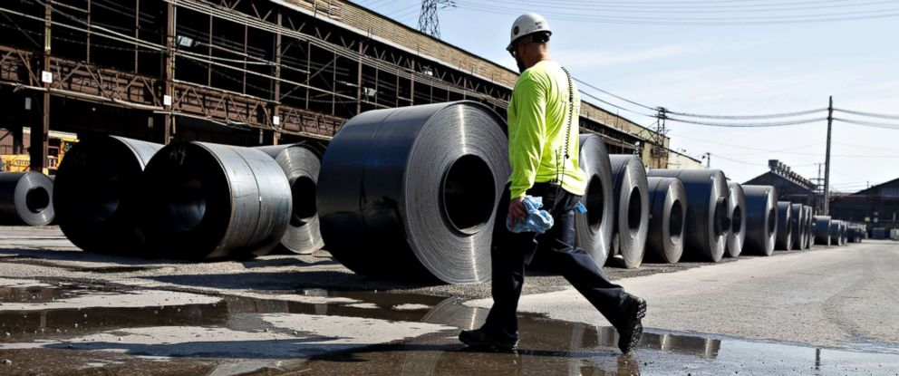 PHOTO: A worker walks past steel coils at the U.S. Steel Corp. Granite City Works facility in Granite City, Ill., July 26, 2018.