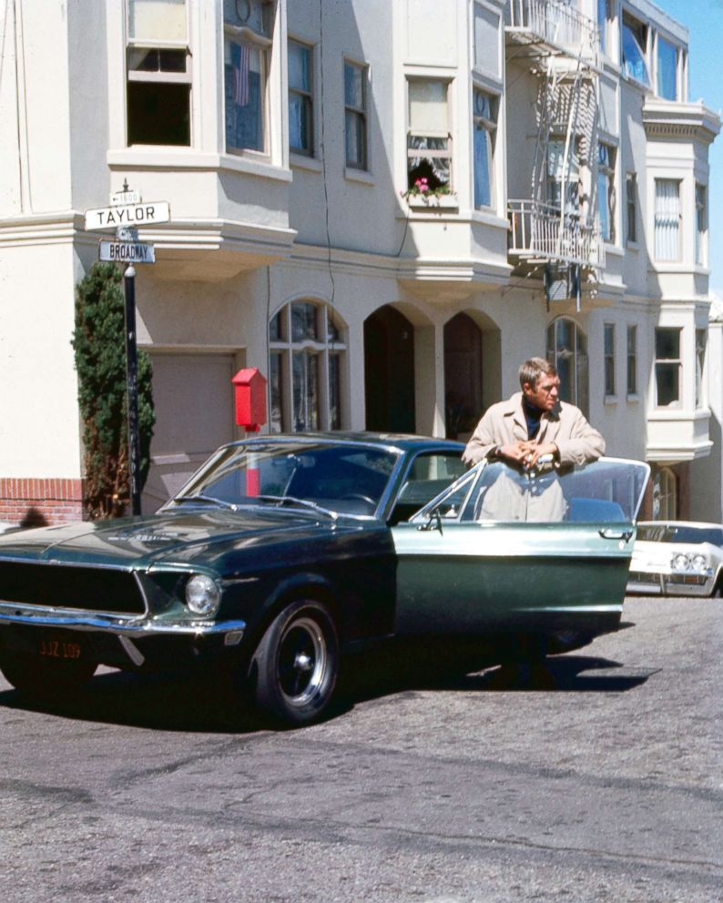 PHOTO: Actor Steve McQueen (1930 - 1980) as Frank Bullitt, next to a Ford Mustang 390 GT 2+2 Fastback in the crime thriller movie Bullitt, in San Francisco, 1968.