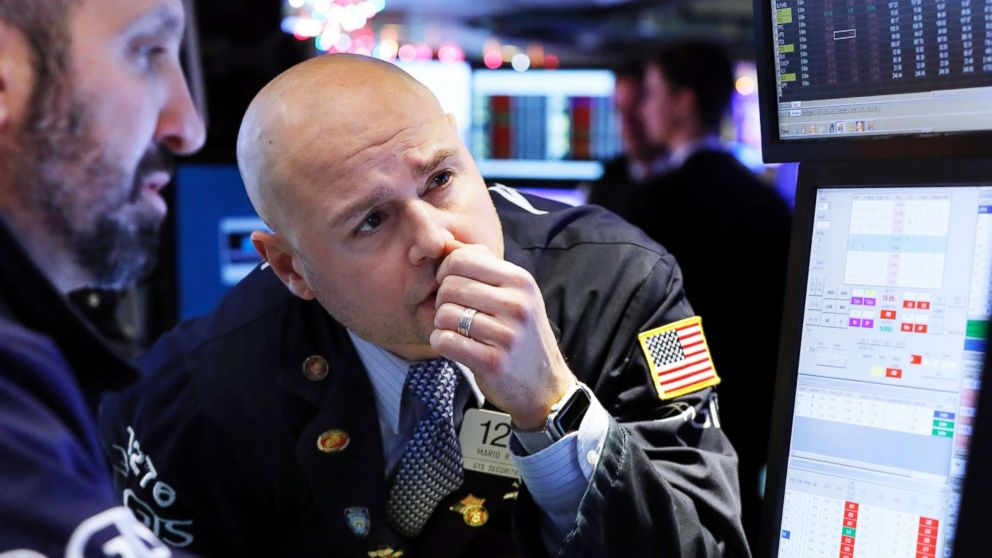 Specialist Mario Picone, center, works on the floor of the New York Stock Exchange, Jan. 2, 2019.
