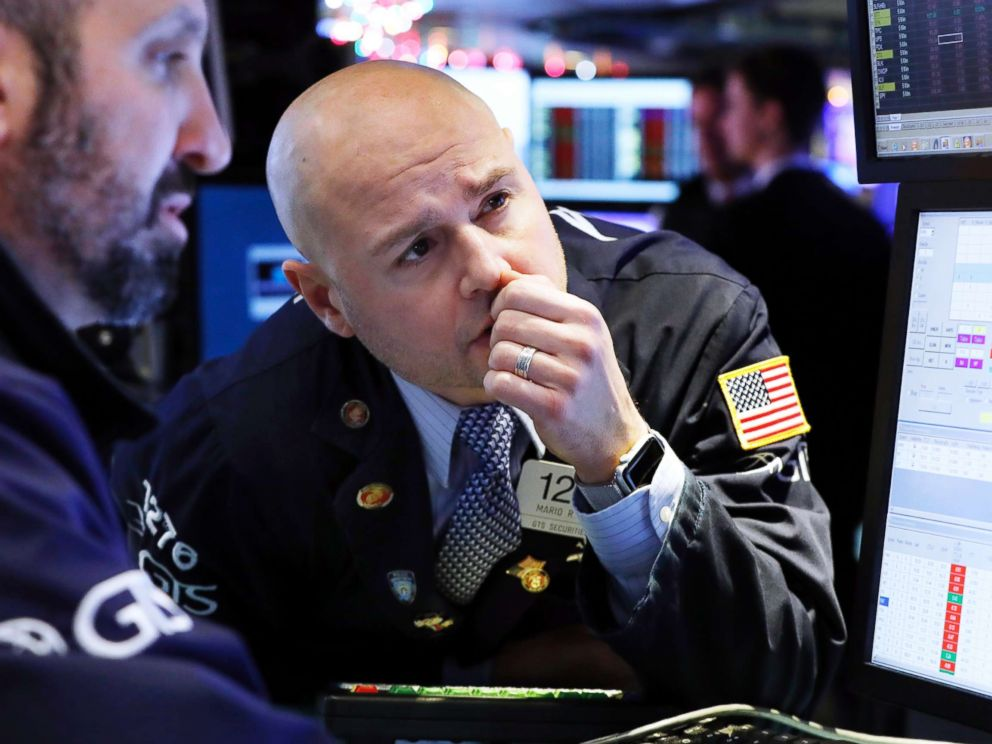 PHOTO: Specialist Mario Picone, center, works on the floor of the New York Stock Exchange, Jan. 2, 2019.