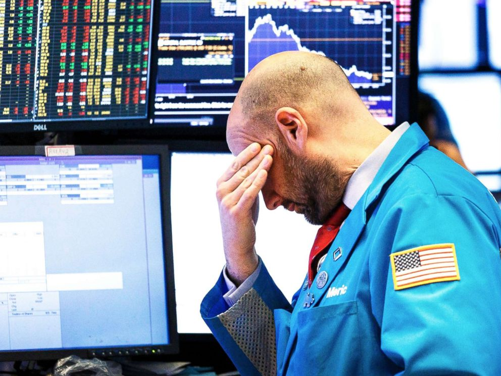 PHOTO: A trader works on the floor of the New York Stock Exchange at the closing bell in New York, Dec., 4 2018.