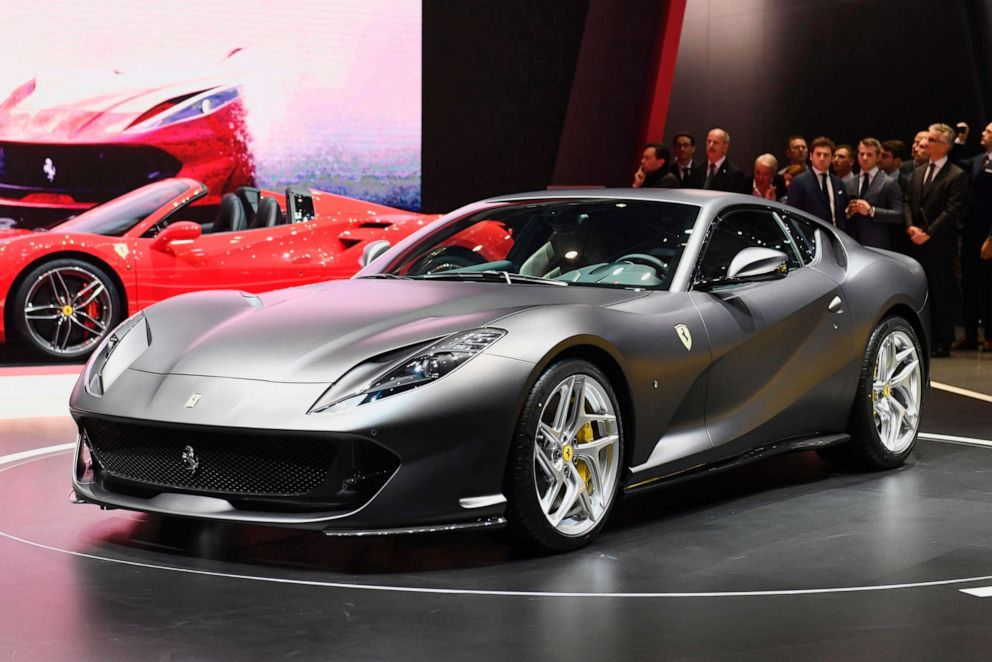 PHOTO: People look at the Ferrari 812 Superfast during the Geneva International Motor Show, March 7, 2017 in Geneva.