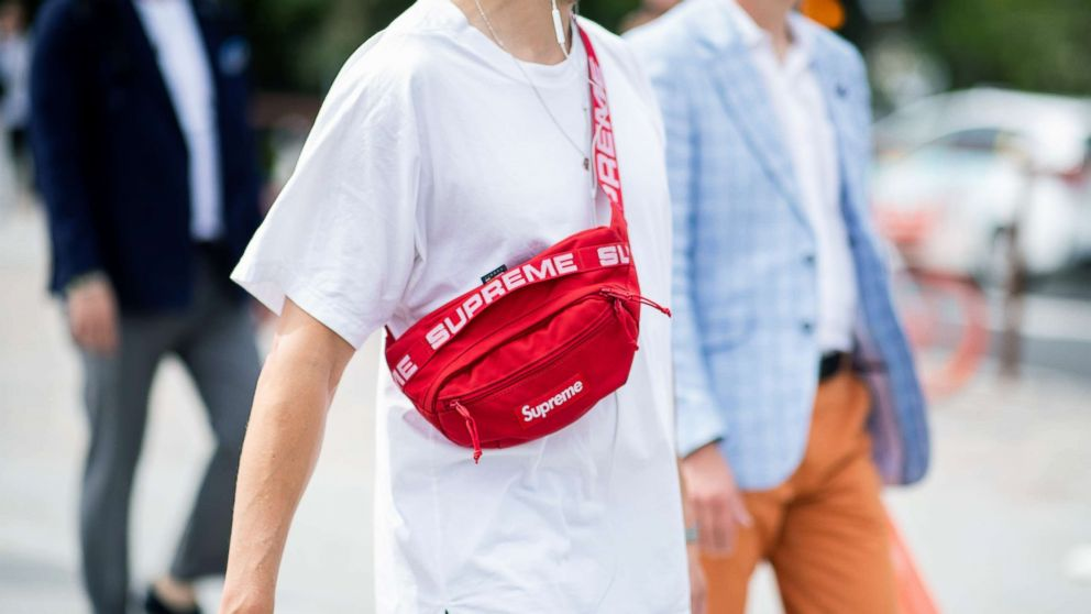 A guest wearing red Supreme belt bag is seen during the 94th Pitti Immagine  Uomo 99dbb5e4c