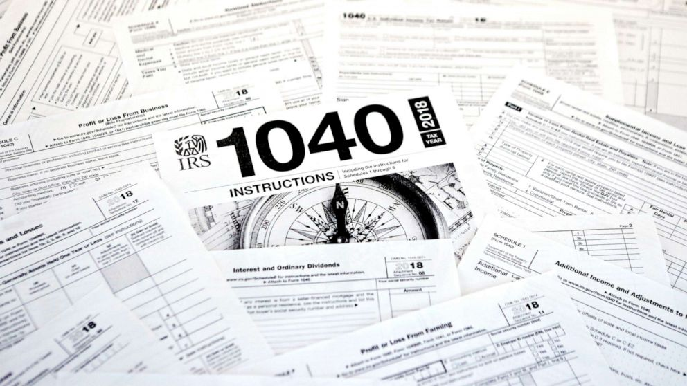 This Feb. 13, 2019, photo shows multiple forms printed from the Internal Revenue Service web page that are used for 2018 U.S. federal tax returns in Zelienople, Pa.