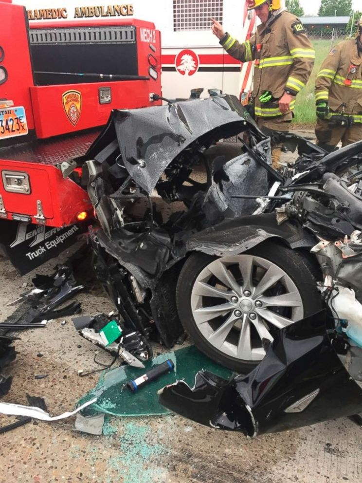 PHOTO: A traffic collision involving a Tesla Model S sedan with a fire department mechanic truck stopped at a red light in South Jordan, Utah, May 11, 2018.