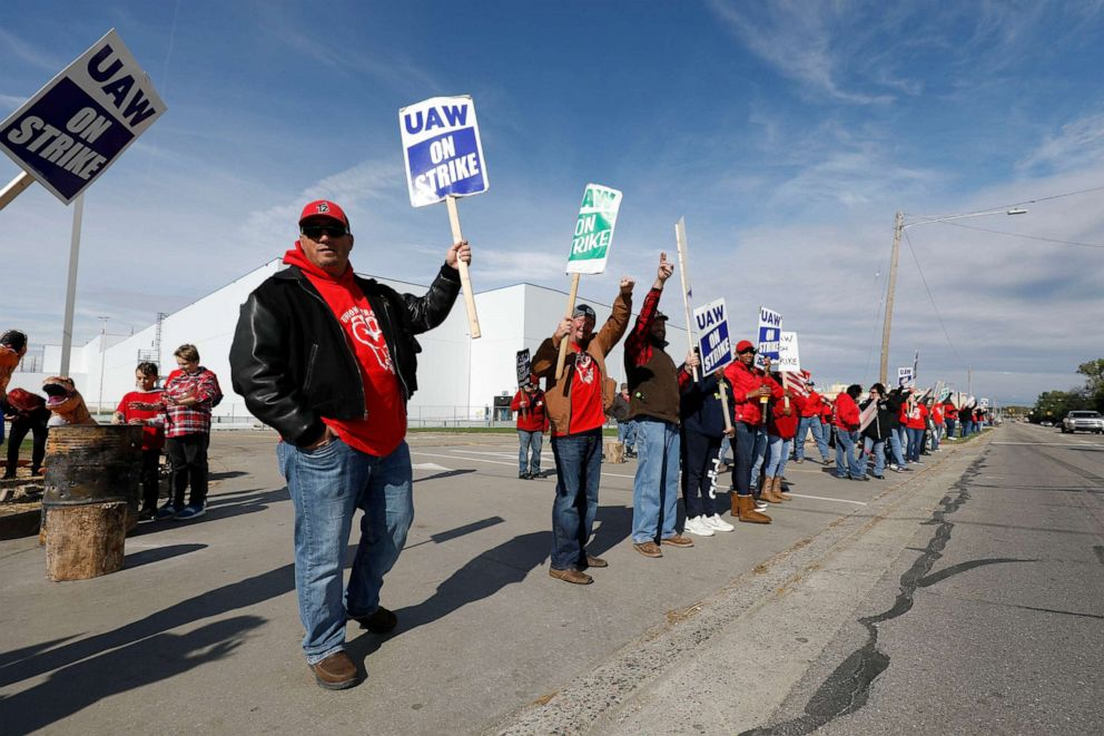 PHOTO: United Auto Workers union members and their families picket at the General Motors Flint Assembly plant on Solidarity Sunday on Oct. 13, 2019, in Flint, Michigan.